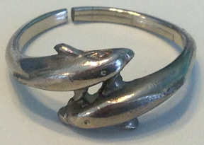 PIcture of silver ring of two dolphins