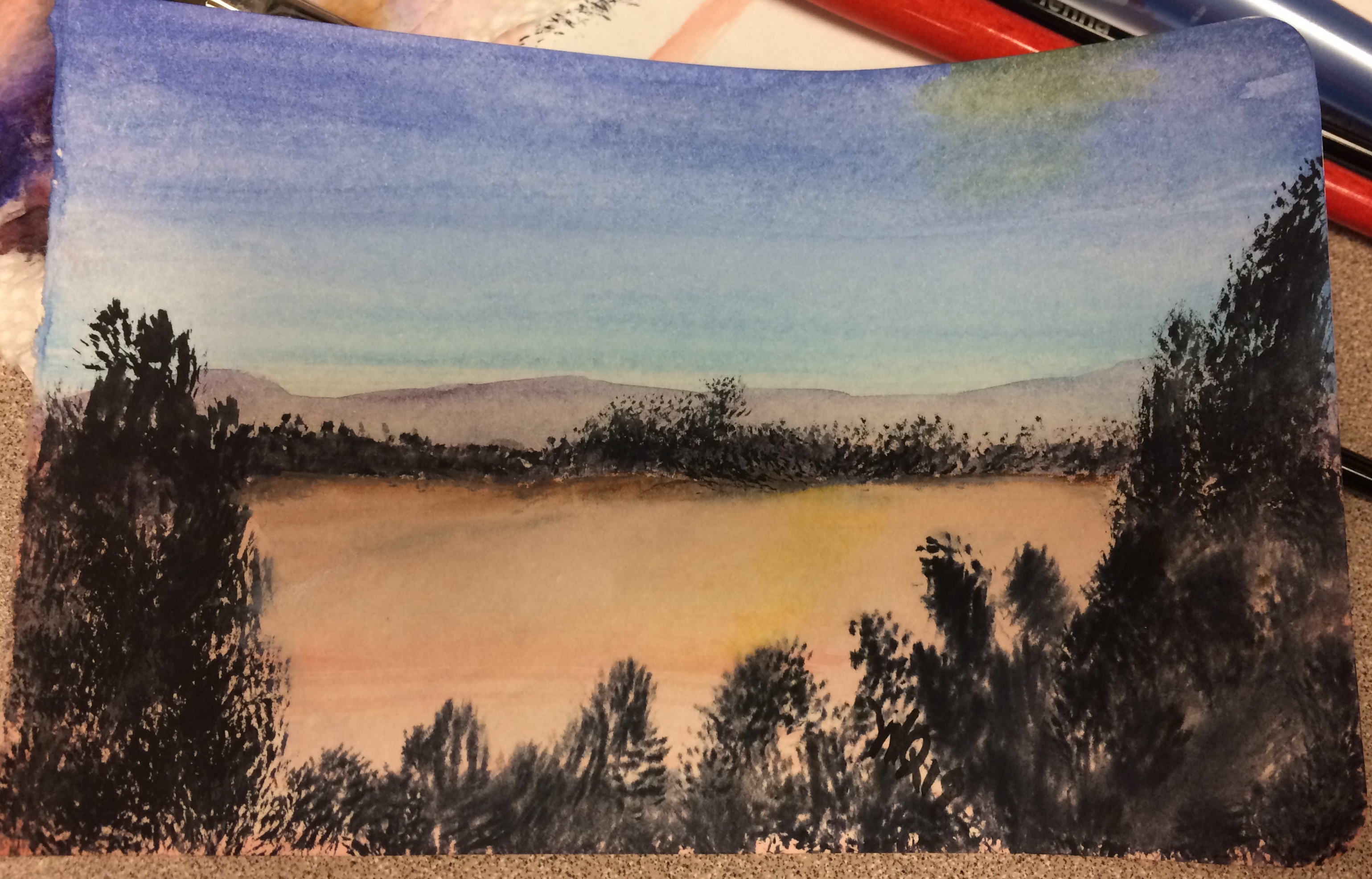 watercolour painting of dawn sky, mountains, silhouetted trees