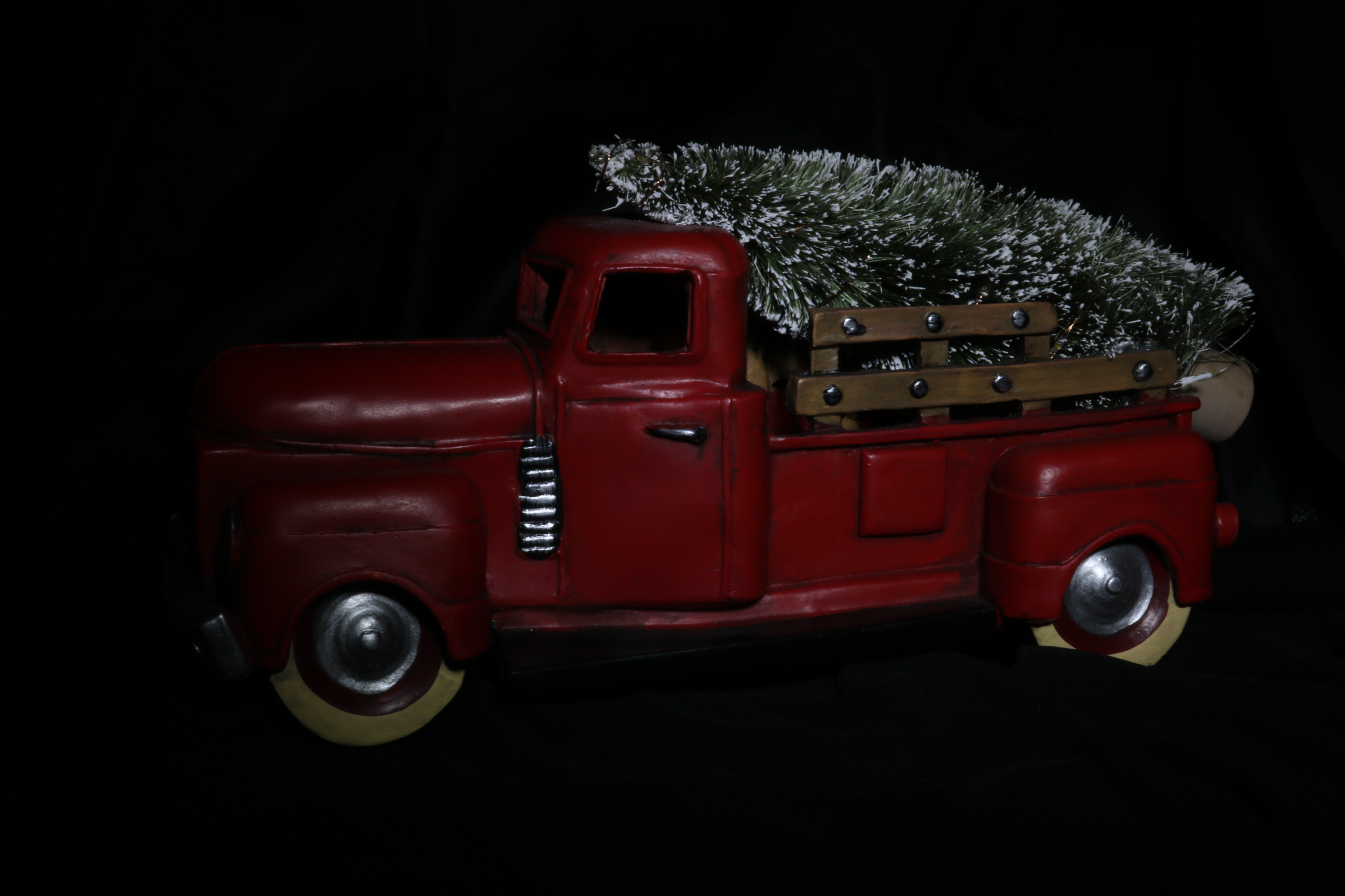 red truck with christmas tree in back