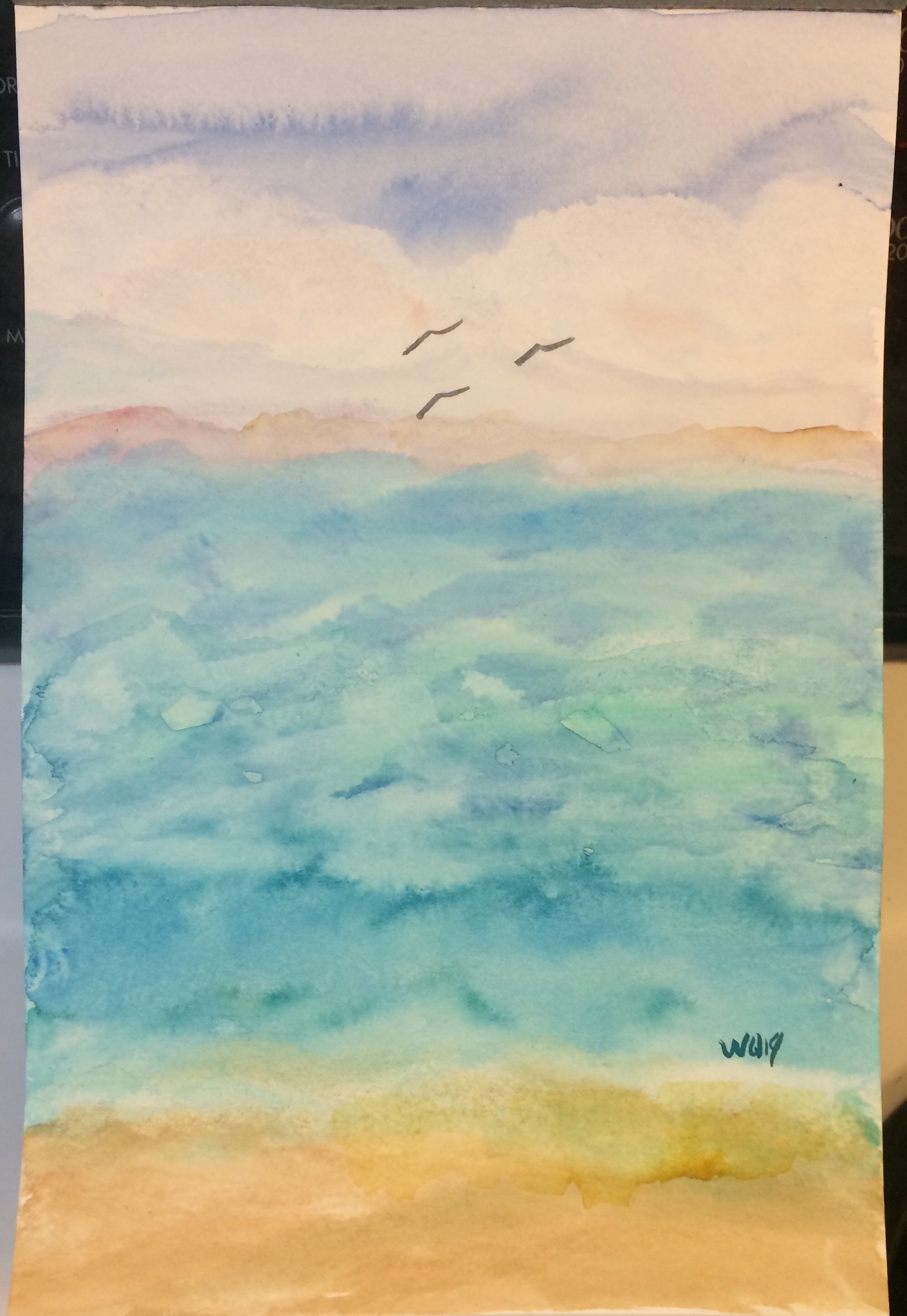 watercolour painting of sky, ocean and a small beach.