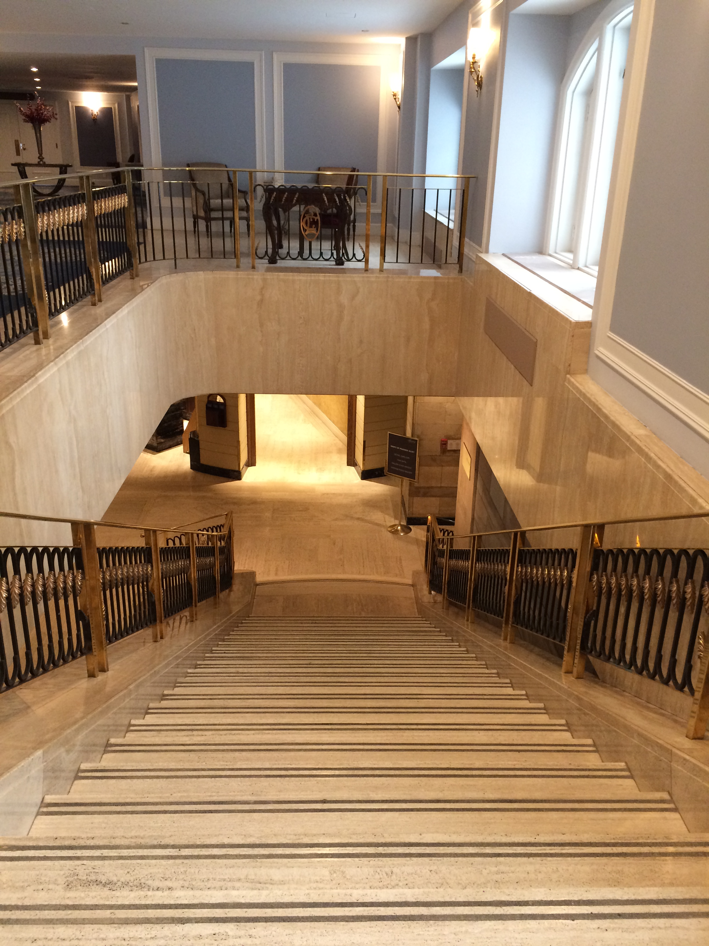 staircase from mezzanine to lobby at fairmont chateau laurier, ottawa, on