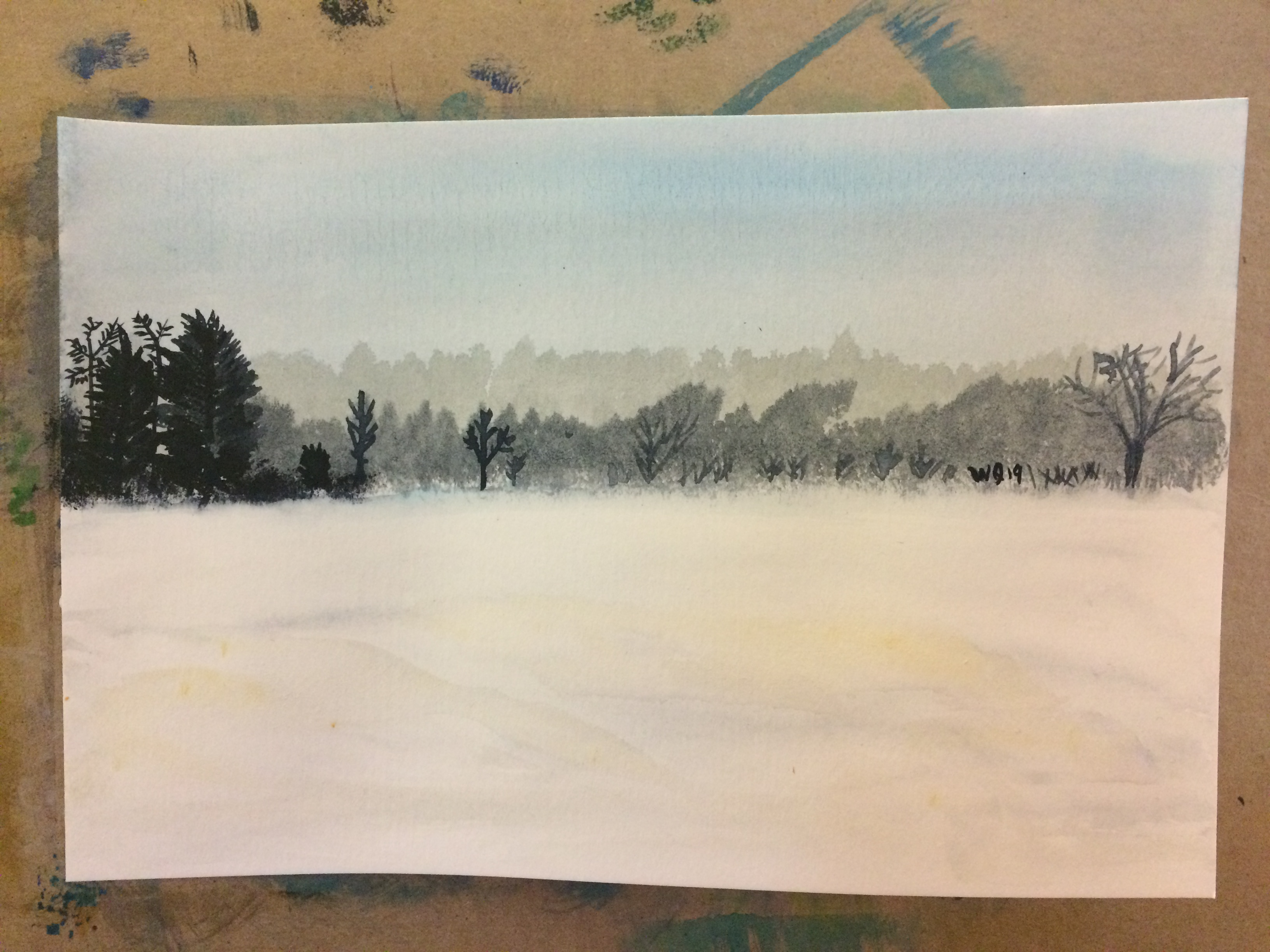 watercolour painting of a landscape trees and a field of snow
