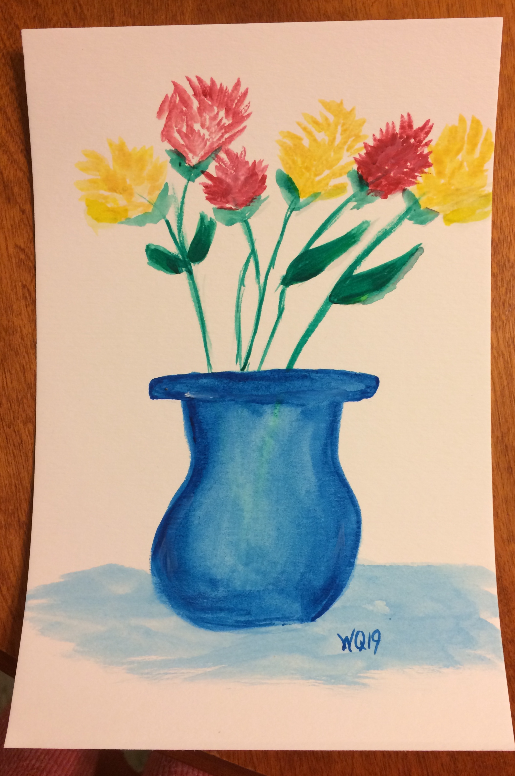 watercolour painting of flowers in a vase.