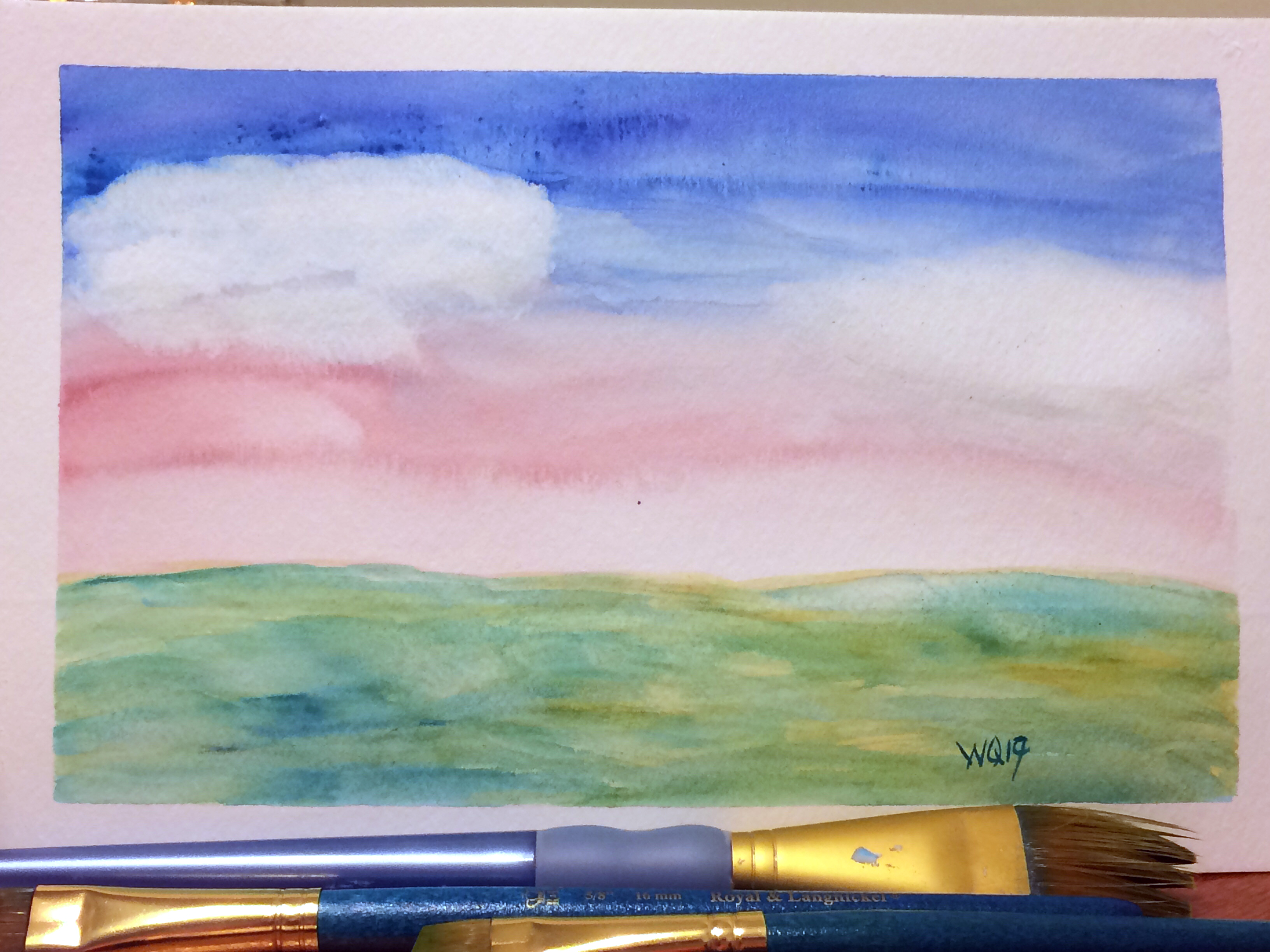watercolour painting landscape of blue and pink sky with two large white clouds and green blue sea or grass.