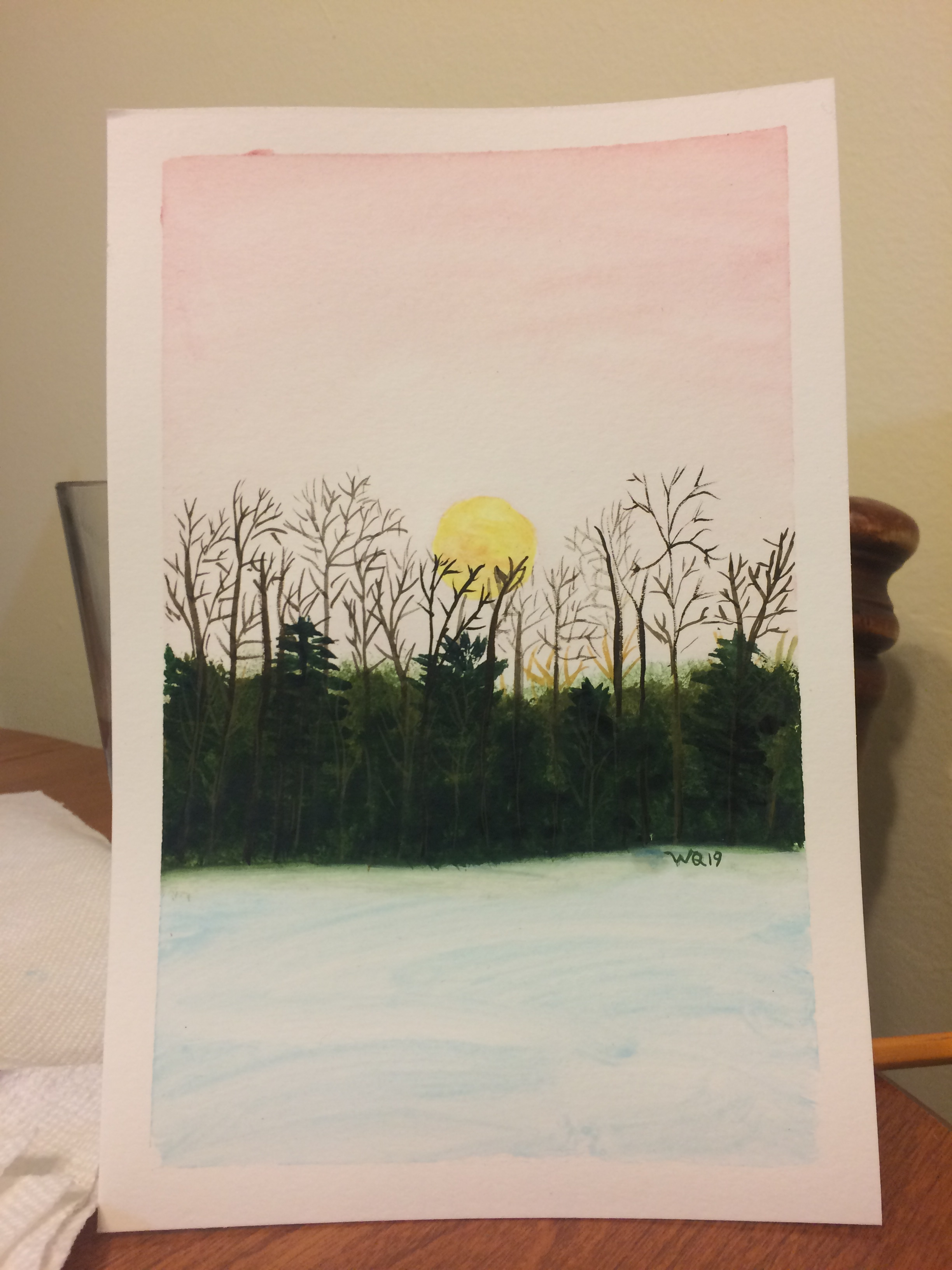 watercolour painting of the full moon setting at sunrise behind trees.