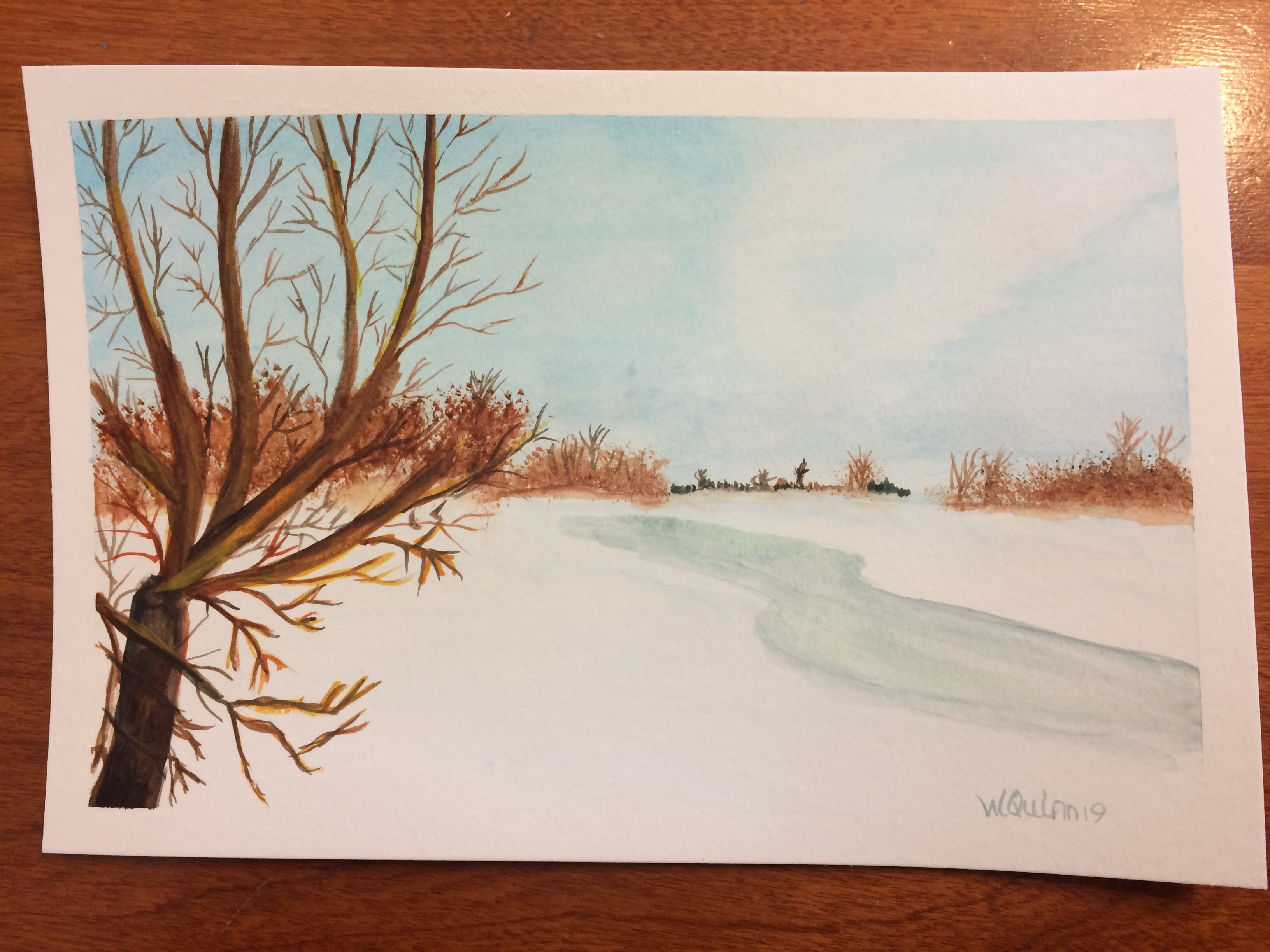 landscape watercolour painting of frozen river with trees around the shoreline.