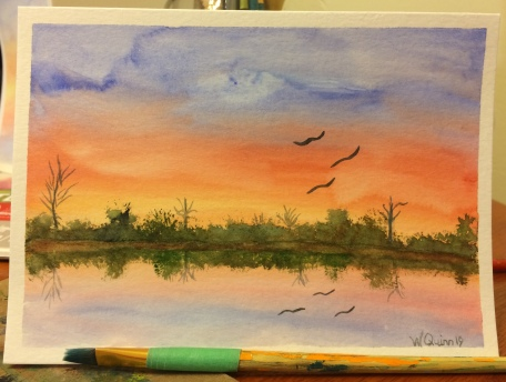 watercolour painting landscape of sunset reflecting in water.