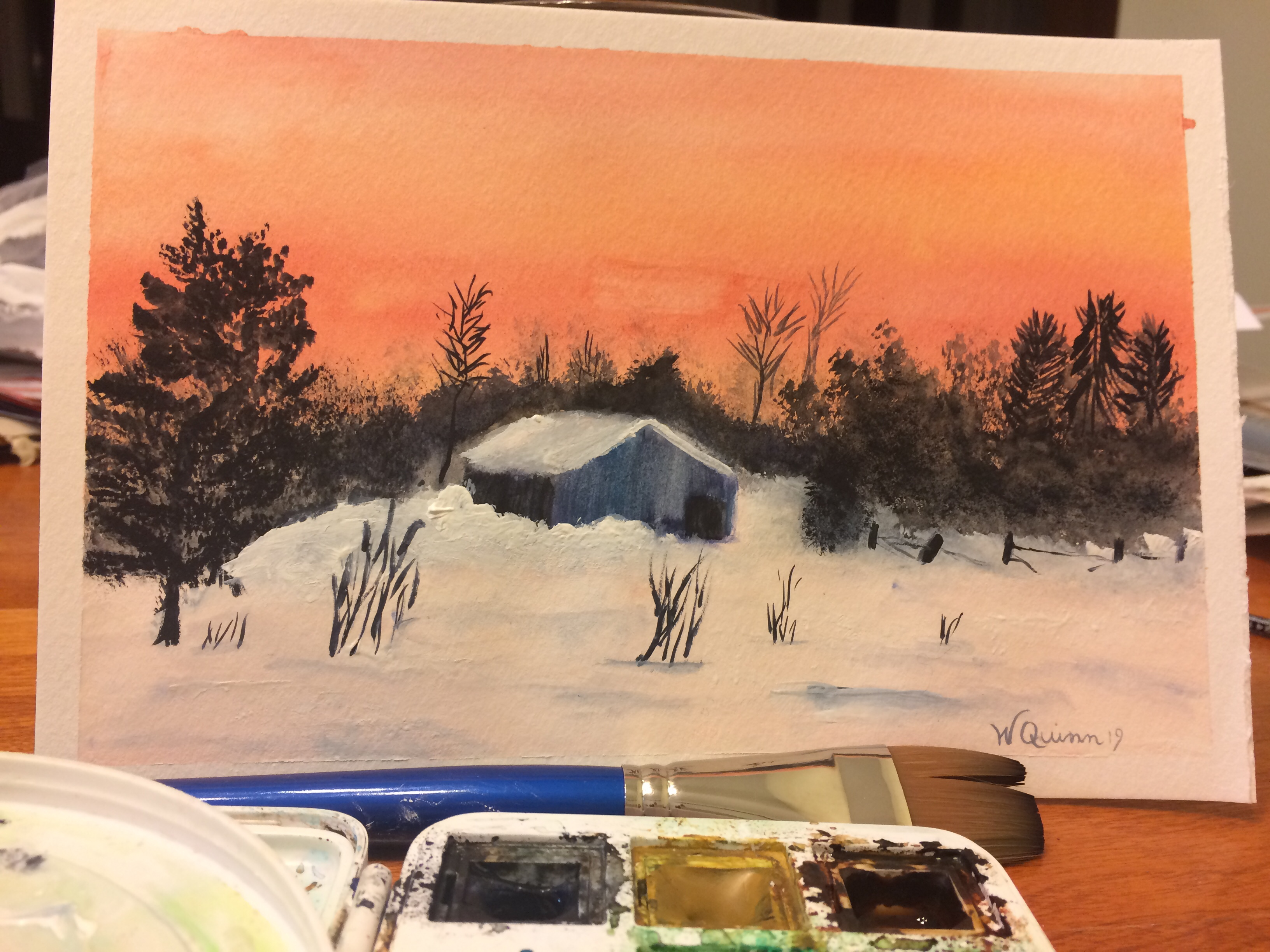 Watercolour painting landscape sunset with a barn in snow