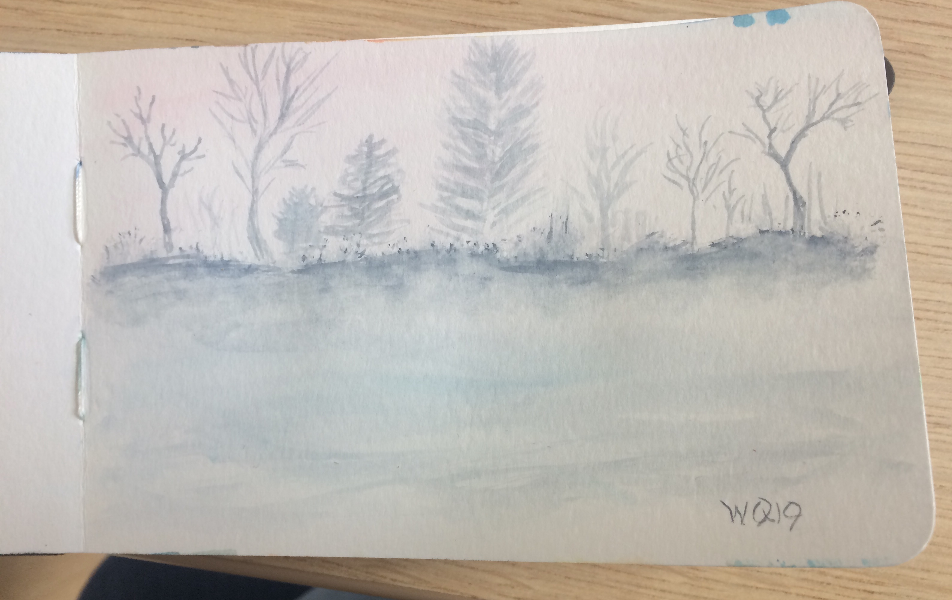 watercolour painting of trees in the snow