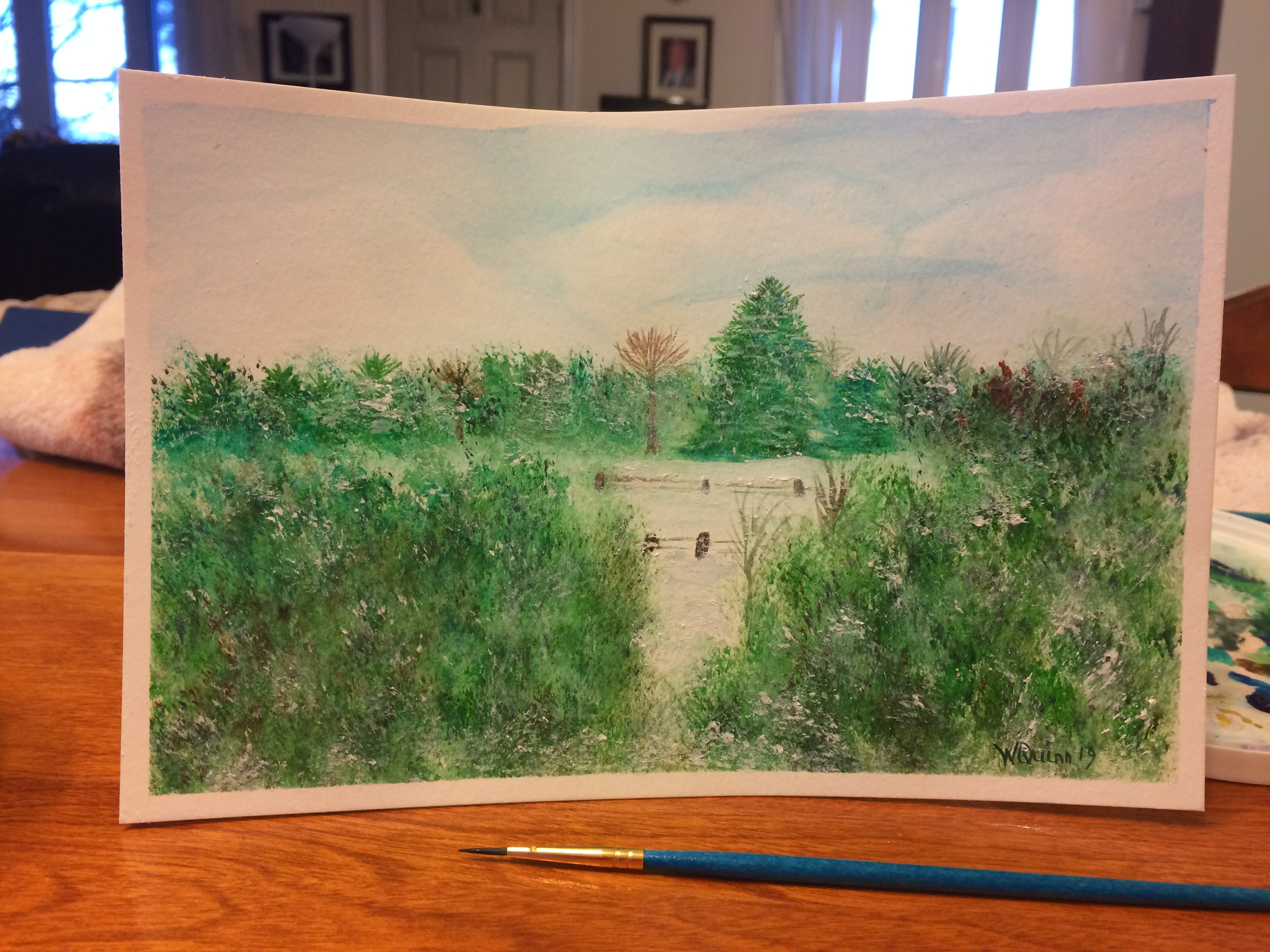 waterrcolour painting landscape of field surrounded by trees