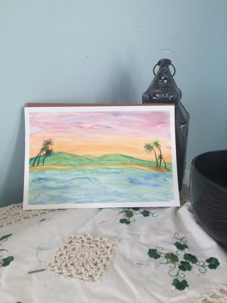 Watercolour painting landscape of hills, beach and water and palm trees