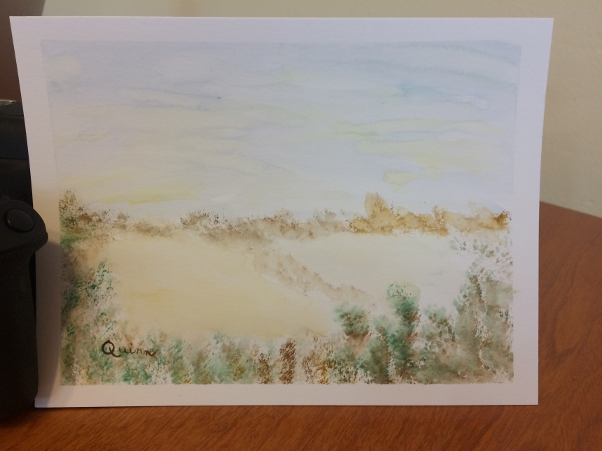 Watercolour painting of sand and brush