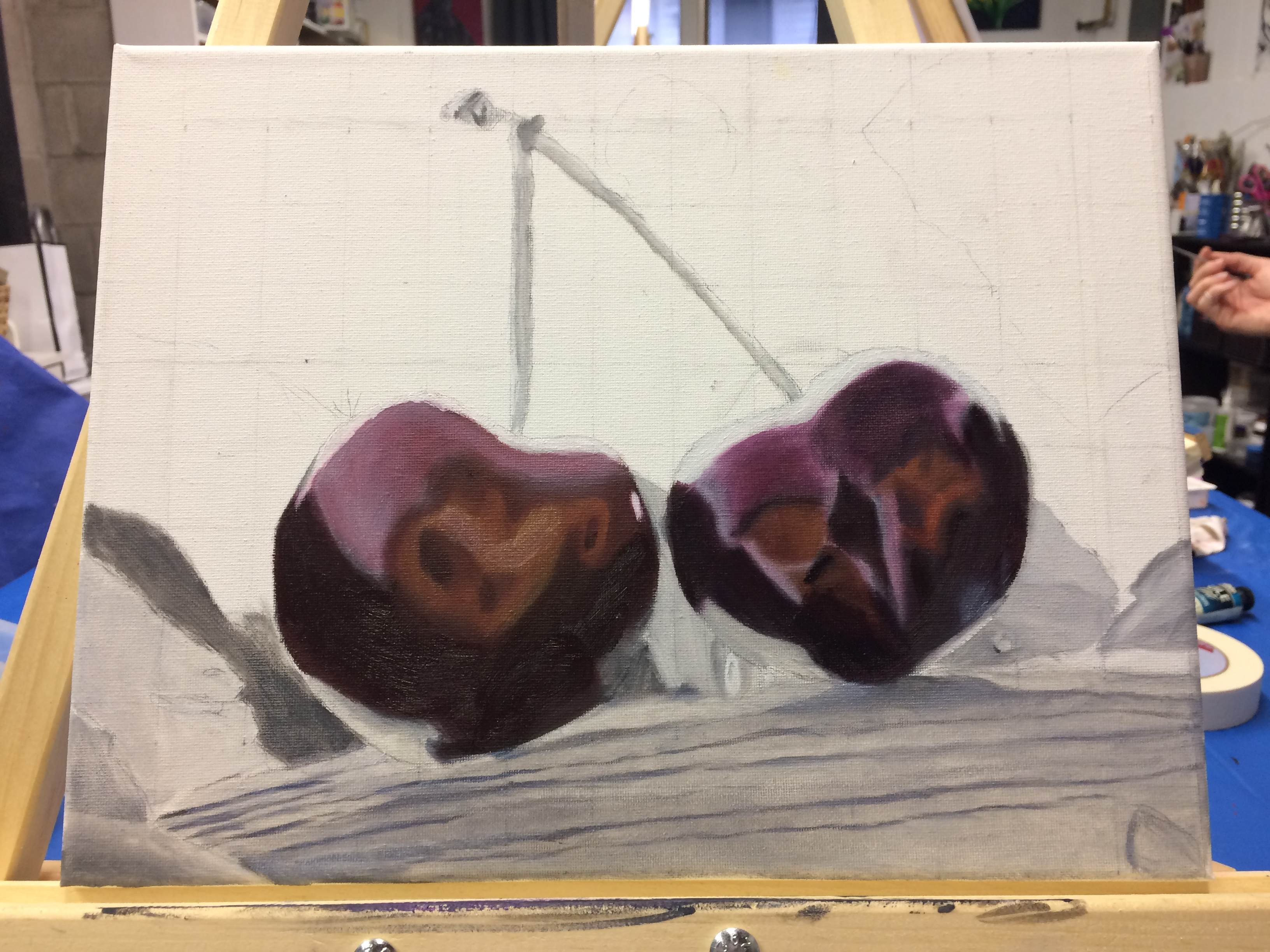 oil painting in progress: white canvas with red cherries painted.