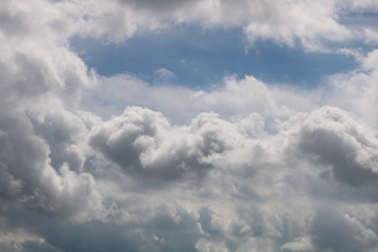 Blue sky behind large white clouds