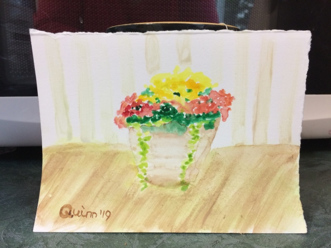 Watercolour painting of flowers in a container
