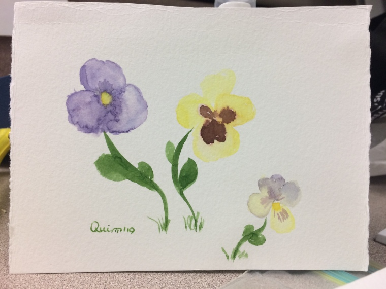 Watercolour painting of three pansies