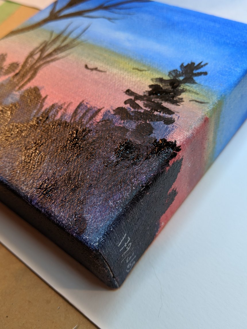 Side view of acrylic sunset painting