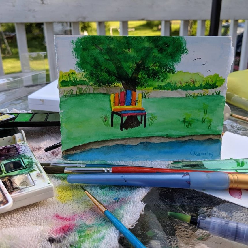 Watercolour painting of park with colourful bench