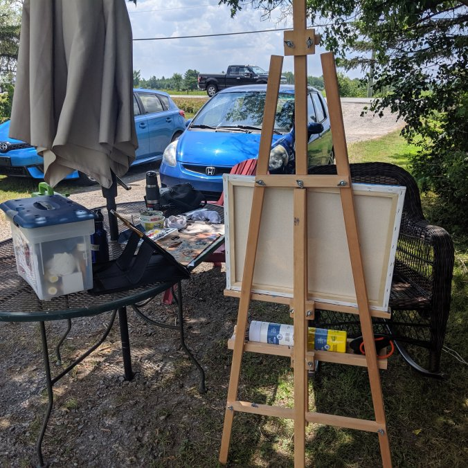 Easel and paints set up for pleinair painting