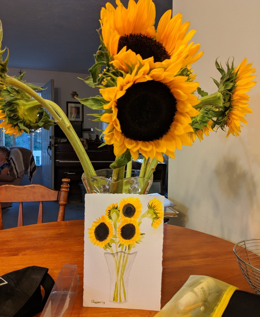 Watercolour painting of sunflowers in a vase