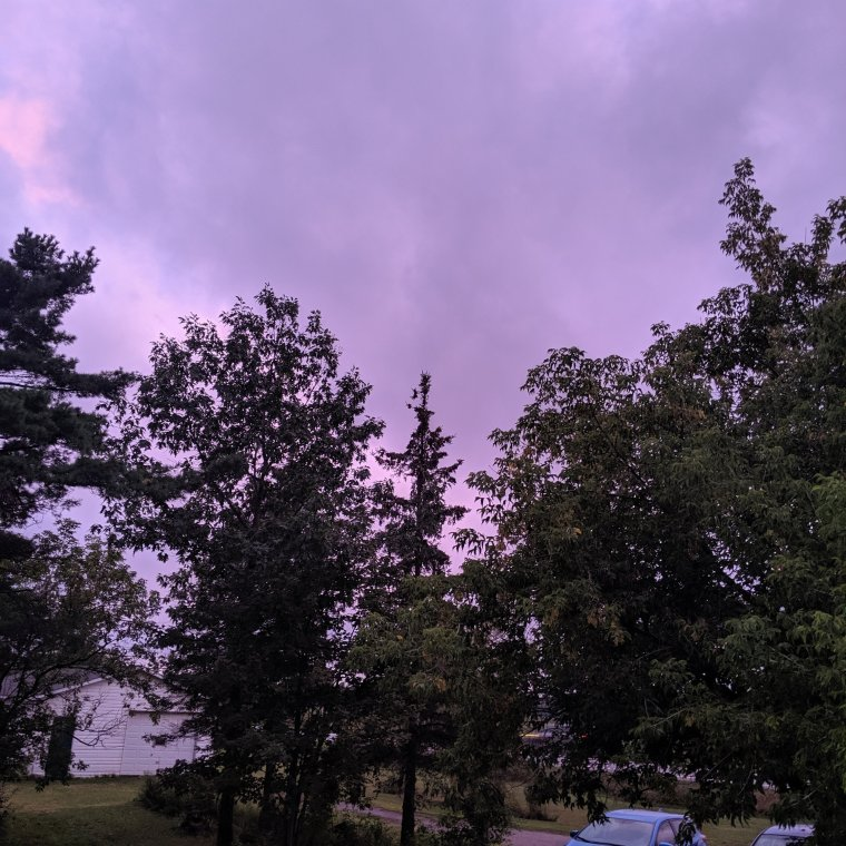 Pink purple cloudy sunset sky