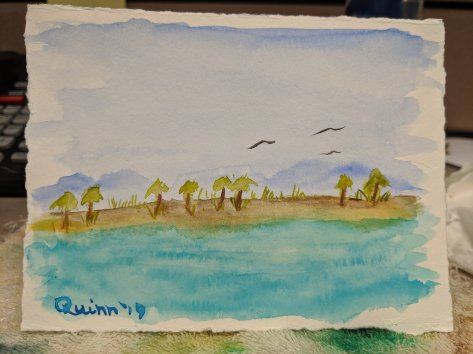 watercolour painting of island with palm trees and water