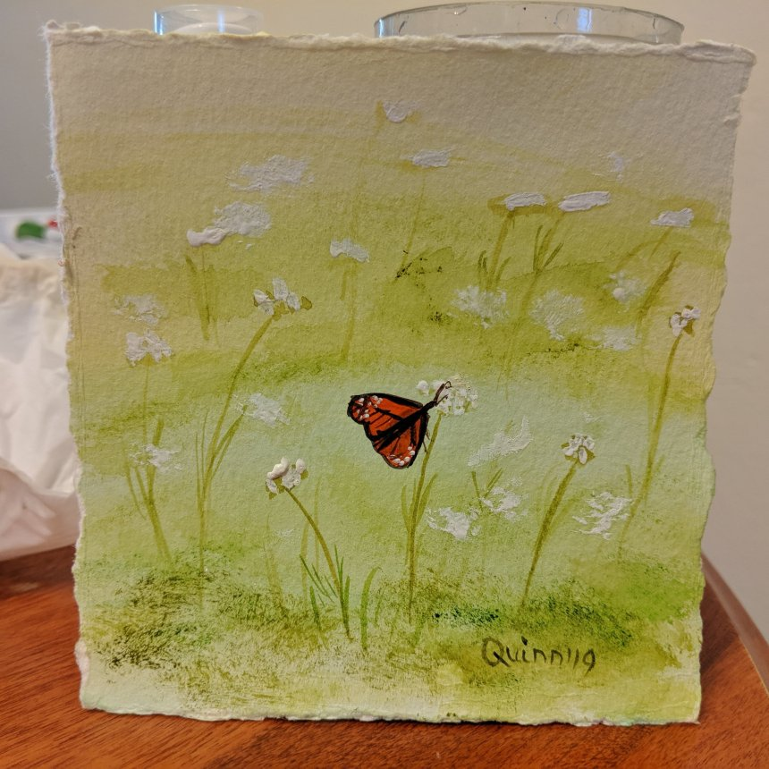 Watercolour painting monarch butterfly on wild flowers