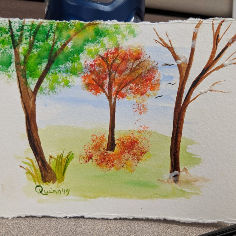 Watercolour painting three trees: summer, autumn and winter