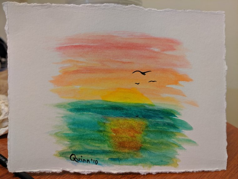 Watercolour painting sunset reflecting on water