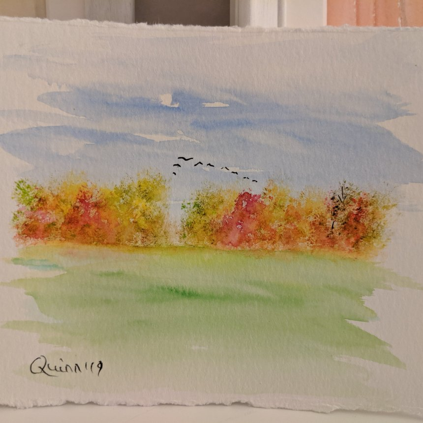 Watercolour painting landscape tree line with coloured leaves and geese in formation flying overhead
