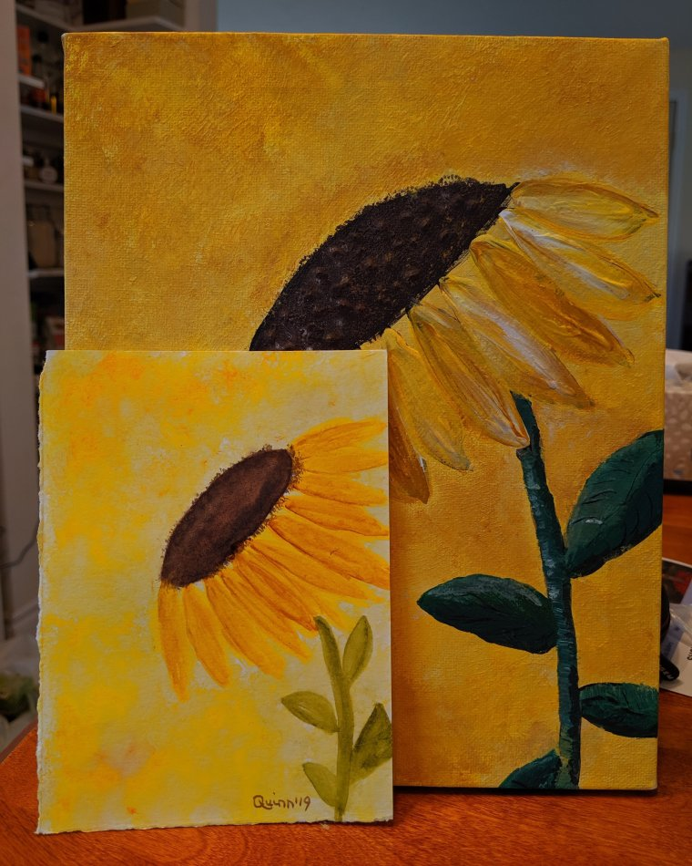 Watercolour painting of a sunflower and an acrylic on canvas of a sunflower