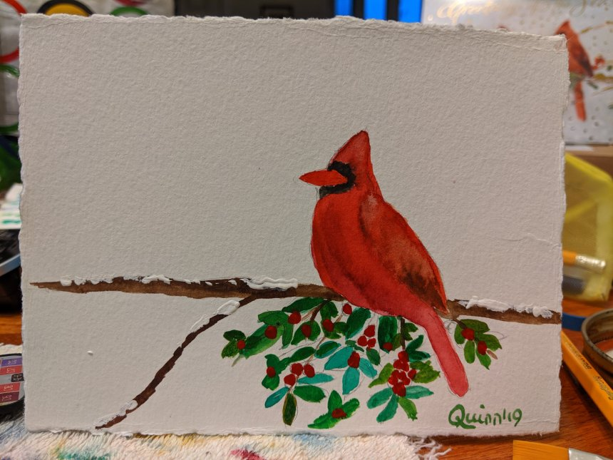 Watercolour painting on white paper of a sideview of a red male cardinal facing left perched on a branch with red berries and green leaves