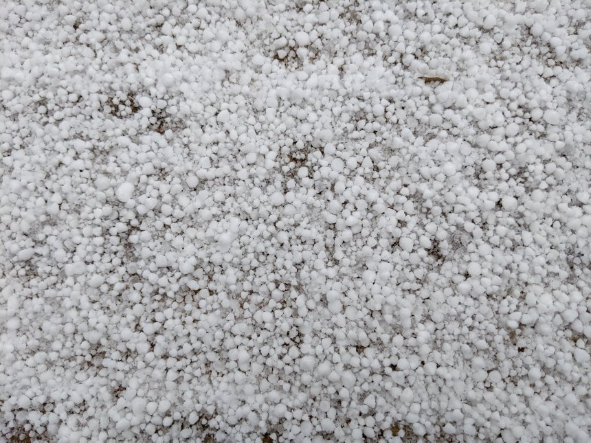 Hail, small 1/4 inch diameter white balls of ice