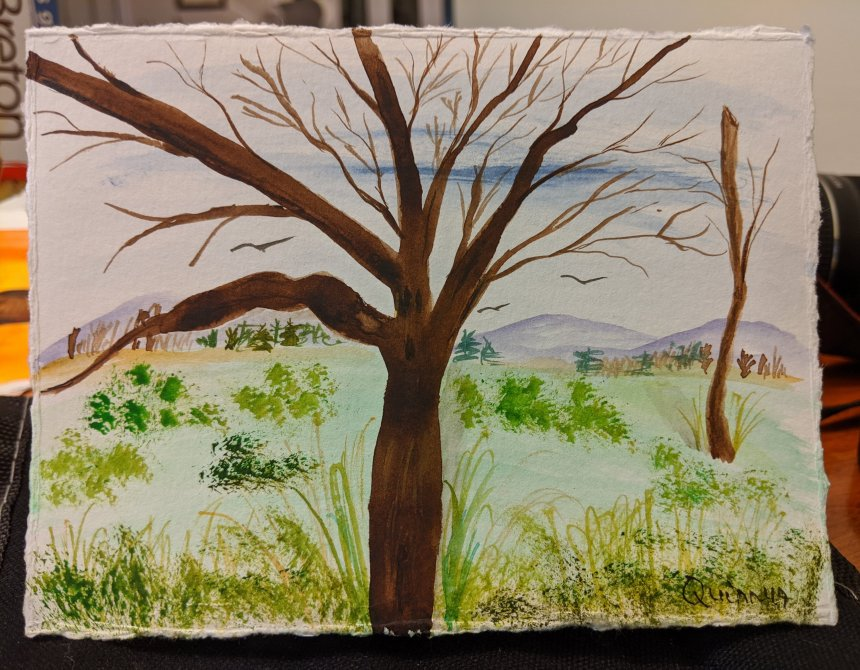 Watercolour painting landscape mountains, meadow with trees on distance and one large brown bare tree in the forefront