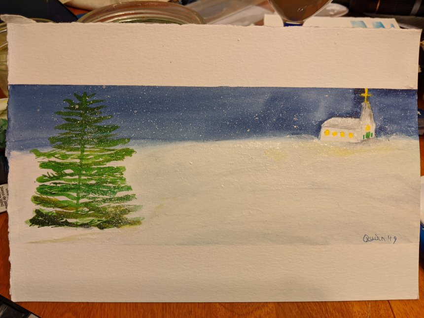 Watercolour painting night scene, evergreen tree in forefront left, snowy field and a small church light up is in the background right