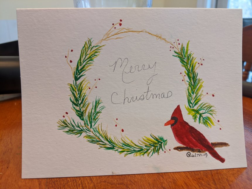 Watercolour painting Christmas wreath with red Cardinal.