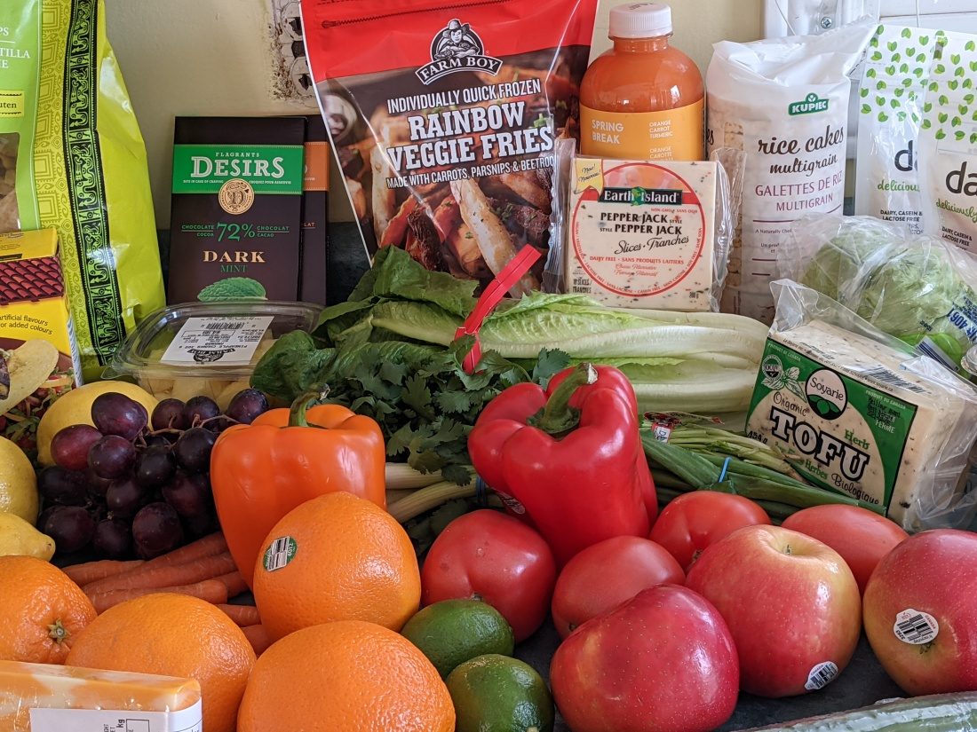 A variety of fruits, vegetables, non dairy products and chocolate